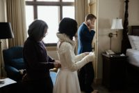 03 The bride was wearing her handmade tulle skirt, a sparkling top with a cutout back, handwarmers, an infinity scarf