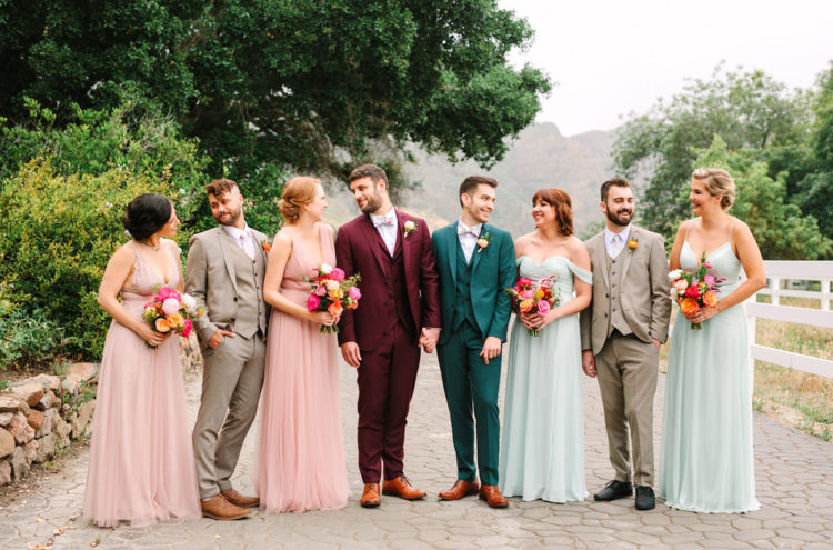 The bridesmaids were wearing pastel pink and green mismatched dresses