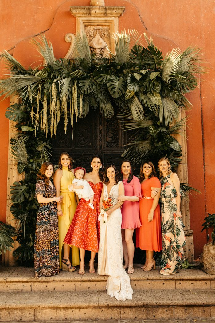 The bridesmaids were rocking mismatching dresses in various muted shades - pink, red, yellow, rust and also printed ones