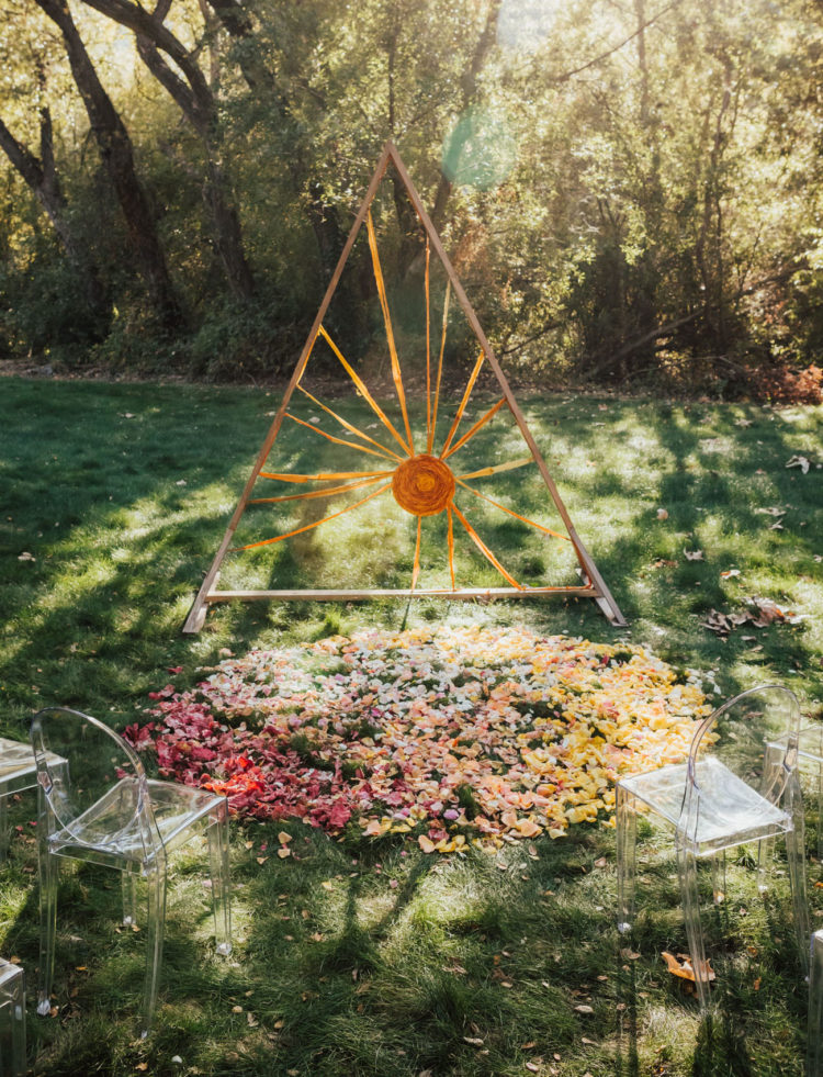 The wedding altar was inspired by the sun and was done with hand-dyed cloth