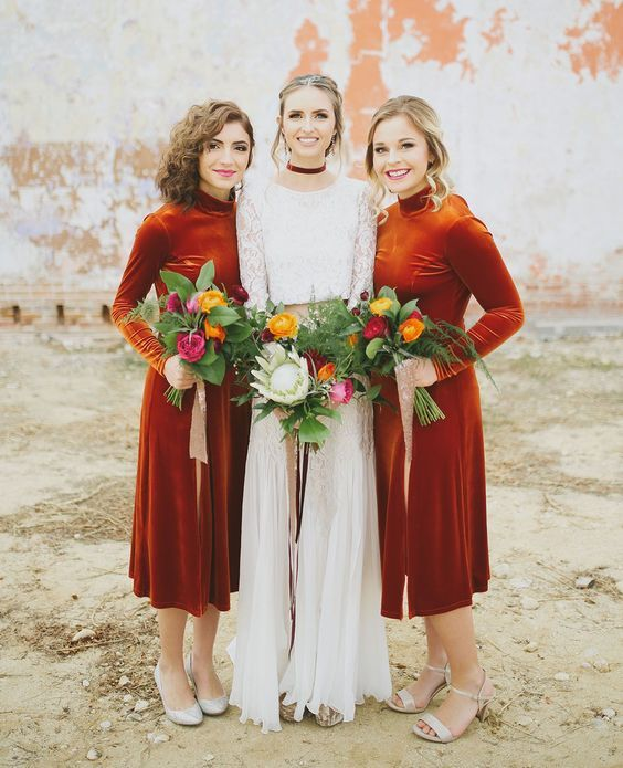 bold rust colored velvet midi bridesmaid dresses with turtlenecks and long sleeves look statement like