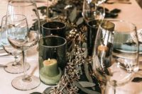 03 simple and chic wedding table styling with eucalyptus and candles in green candleholders plus mint napkins