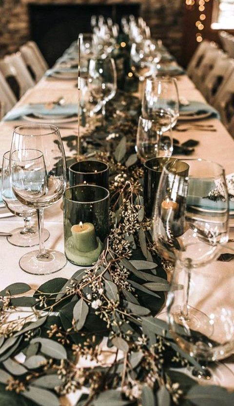 simple and chic wedding table styling with eucalyptus and candles in green candleholders plus mint napkins