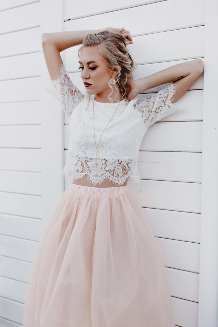 Her wedding ensemble was a white lace crop top and a blush maxi skirt