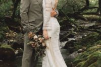 04 The bride was rocking a boho lace fitting wedding dress with long sleeves and a lace up back
