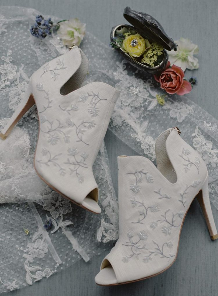 The bride was wearing embroidered cutout booties with heels