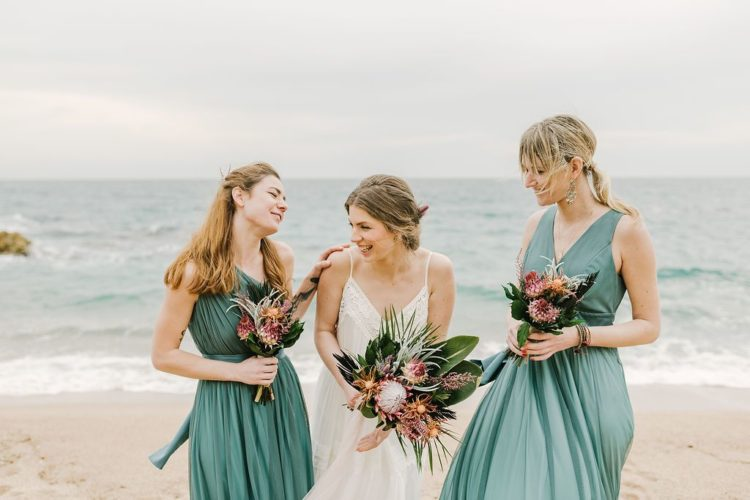 The bridesmaids were rocking green draped maxi dresses