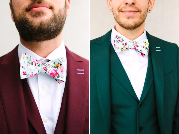 The grooms were rocking a burgundy and an emerald three-piece suit plus mathcing floral bow ties