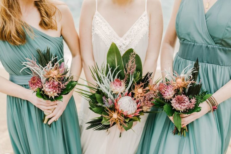 All the girls were carrying tropical bouquets with king proteas, tropical foliage and succulents