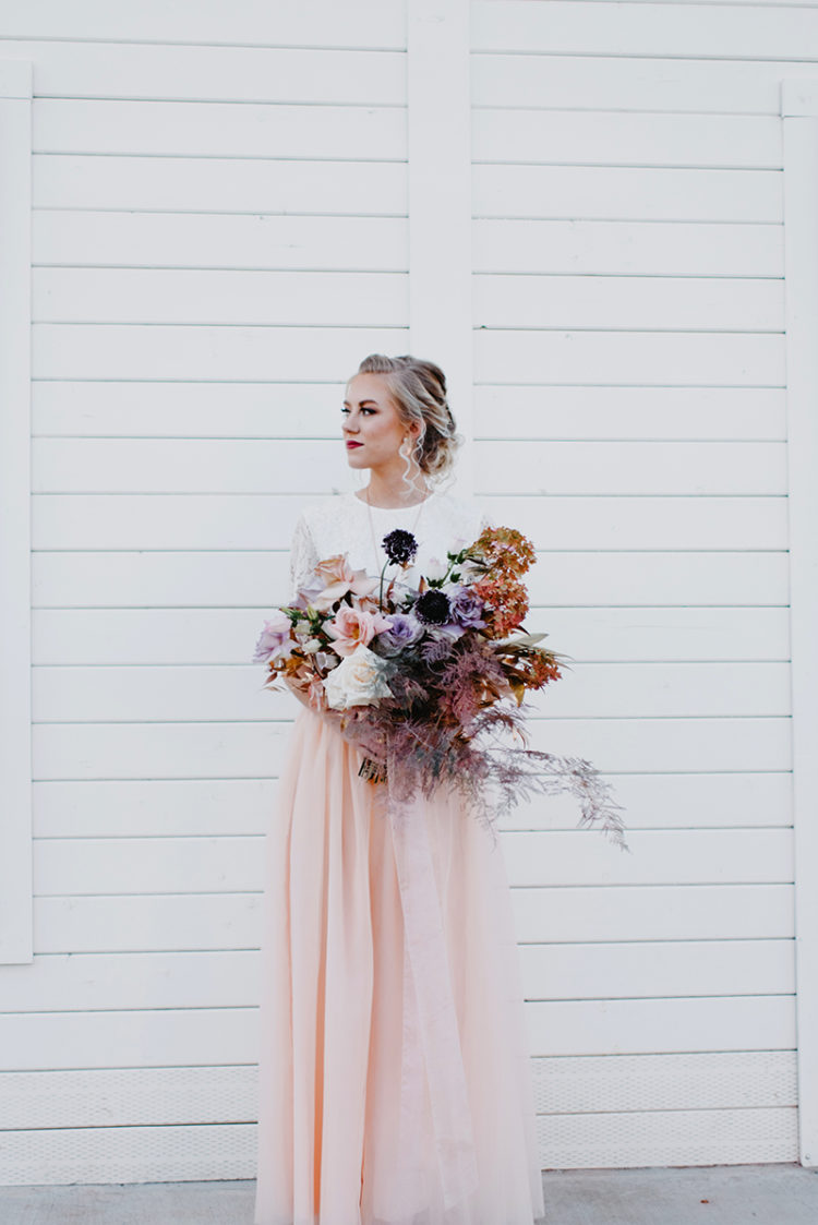 The bouquet was done in blush, neutrals, rust and purple for a chic and cool look
