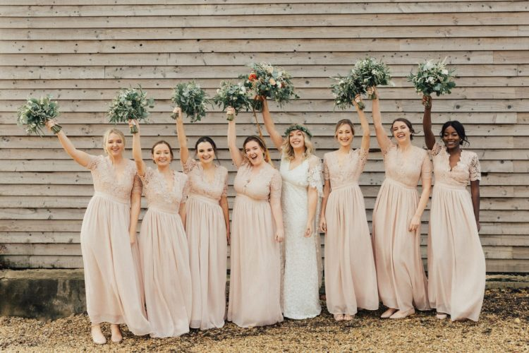 The bridesmaids were wearign matching blush maxi dresses with lace bodices