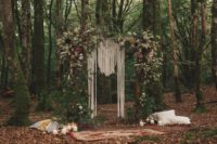 05 The wedding arch was a lush one, done with lots of greenery and blooms, ome herbs and pampas grass