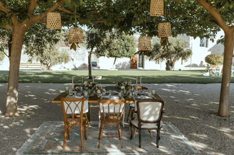 The wedding reception was an outdoor one, with woven lamps and a cozy styled table