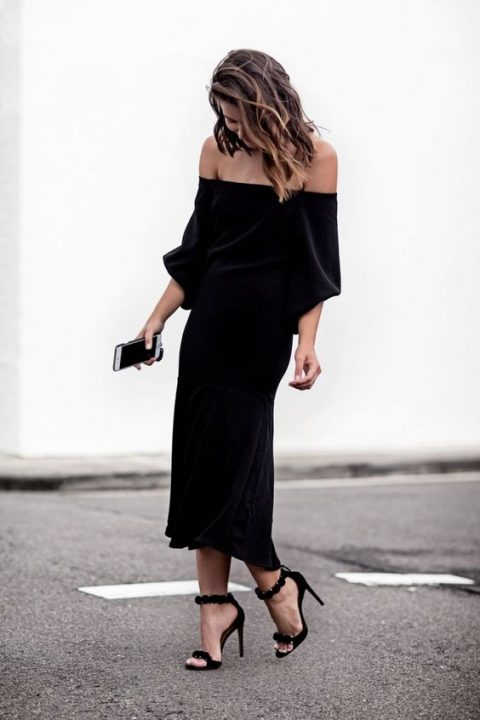 a black velvet off the shoulder midi dress with long sleeves, ankle strap shoes in black with pompoms