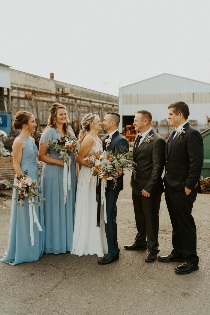 The bridesmaids were rocking aqua blue maxi dresses with ruffles and the groomsmen were wearing black tuxes