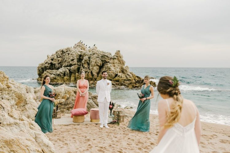 The ceremony space was right on the beach, with a chic lounge - stools and candle lanterns