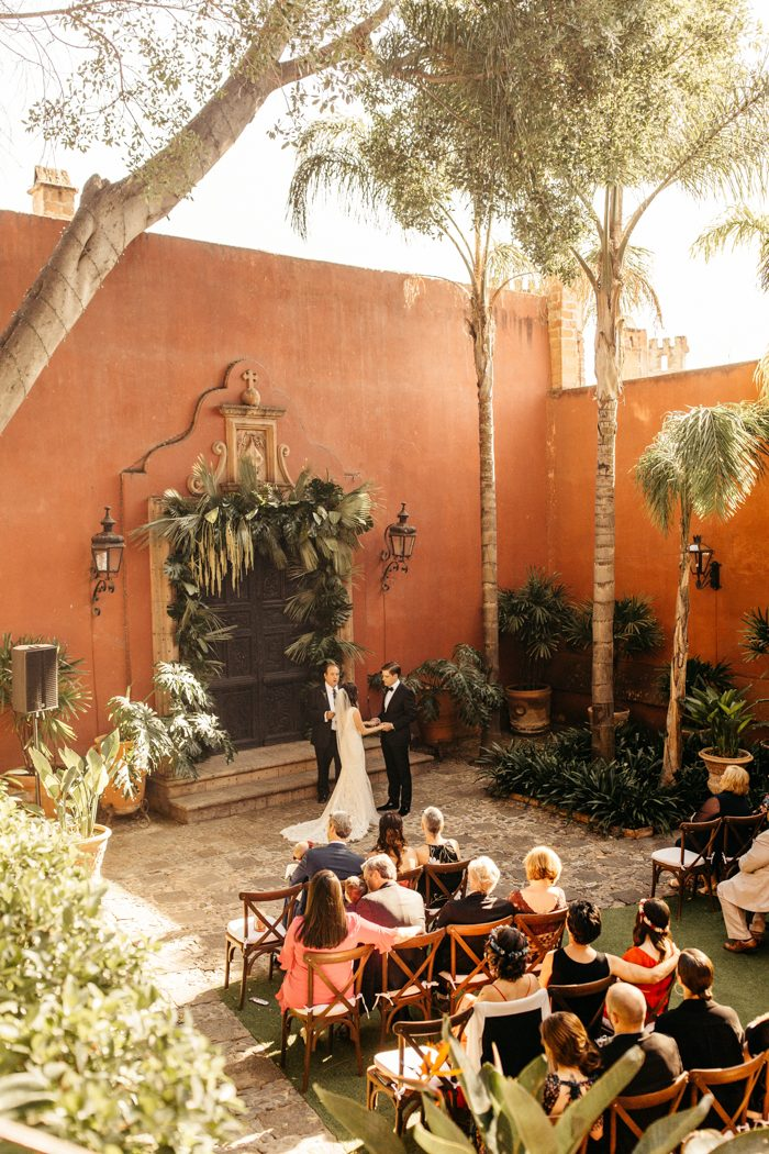 The ceremony took place in the courtyard of the venue, which was full of greenery and didn't require much decor