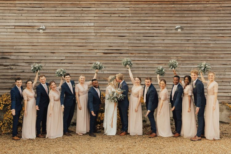 The groomsmen were wearing navy suits with blush ties just like the groom