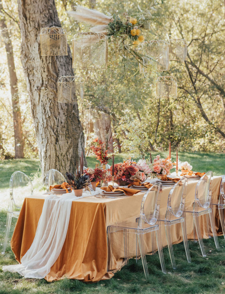 The wedding reception was done in bold sunset shades and with woven cages over the table