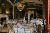 06 The wedding reception was done with elegance and a refiend taste – with chic chandeliers, white tablescapes and some gold touches