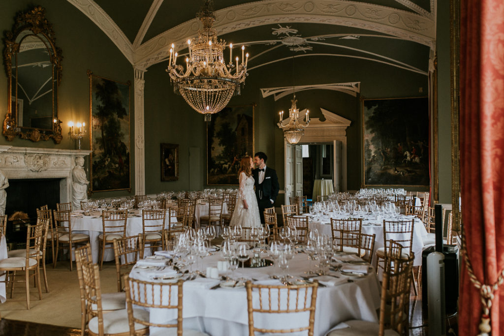 The wedding reception was done with elegance and a refiend taste   with chic chandeliers, white tablescapes and some gold touches