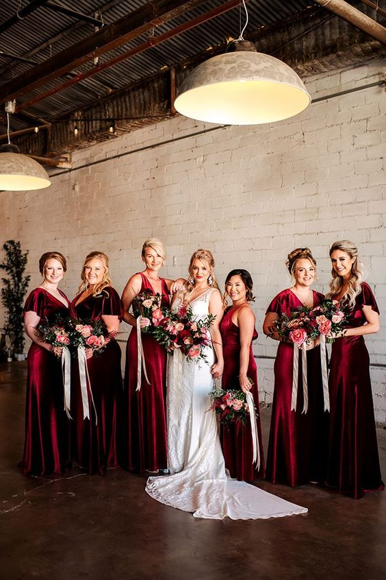 deep red velvet maxi bridesmaid dresses are a nice idea for fall or winter weddings