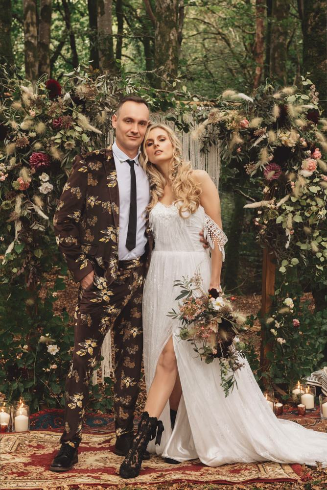 The groom was wearing a dark floral print suit