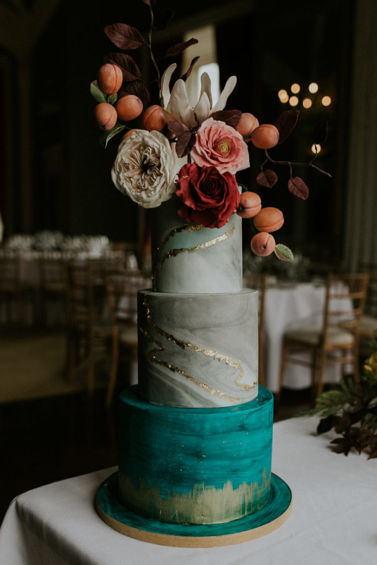 The wedding cake was a grey marble one, with a bold turquoise tier, metallic touches, lush blooms, foliage and apricots