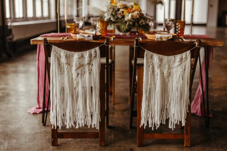 The wedding chairs were decorated with white macrame