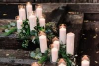 07 cozy and simple ceremony space decor with greenery and tall white candles is very cool and feels quite modern