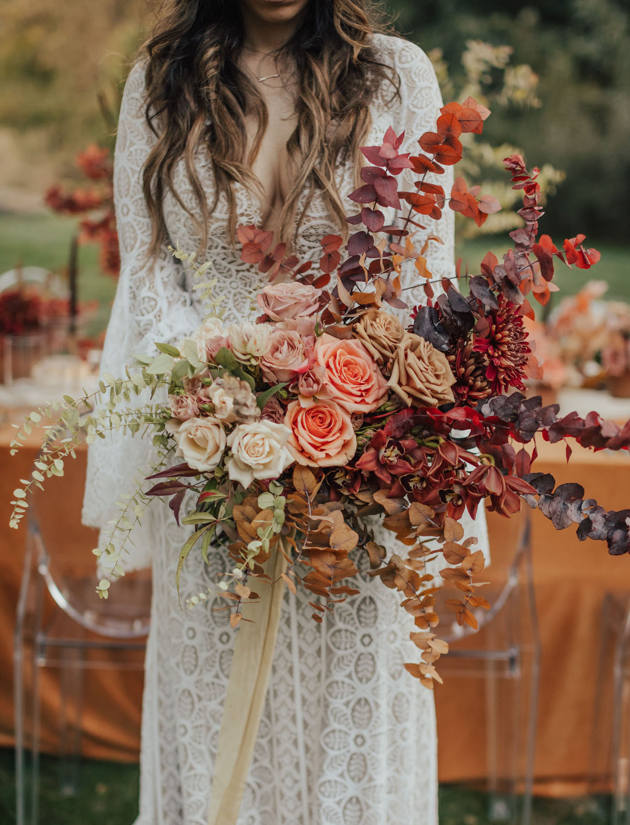 The gorgeous bridal bouquet was done with dried and fresh foliage, bold blooms and long ribbons