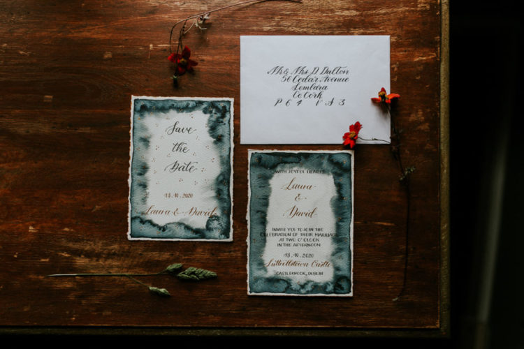 The wedding stationery was done with agate-like watercolors, elegant calligraphy and gold touches