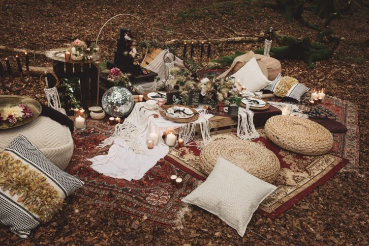 There was a lush boho picnic styled for the shoot, with rugs, jute ottomans, tablecloths and pillows