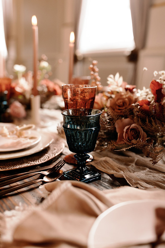 There were muted colored napkins, metal chargers, sweet blooms and vintage cutlery