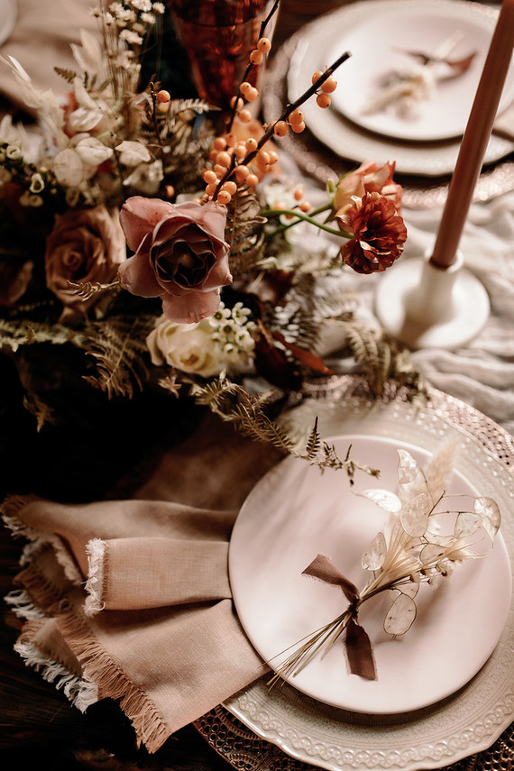 Refined lace-like placemats and deep-colored blooms added a chic and sophisticated touch to the table