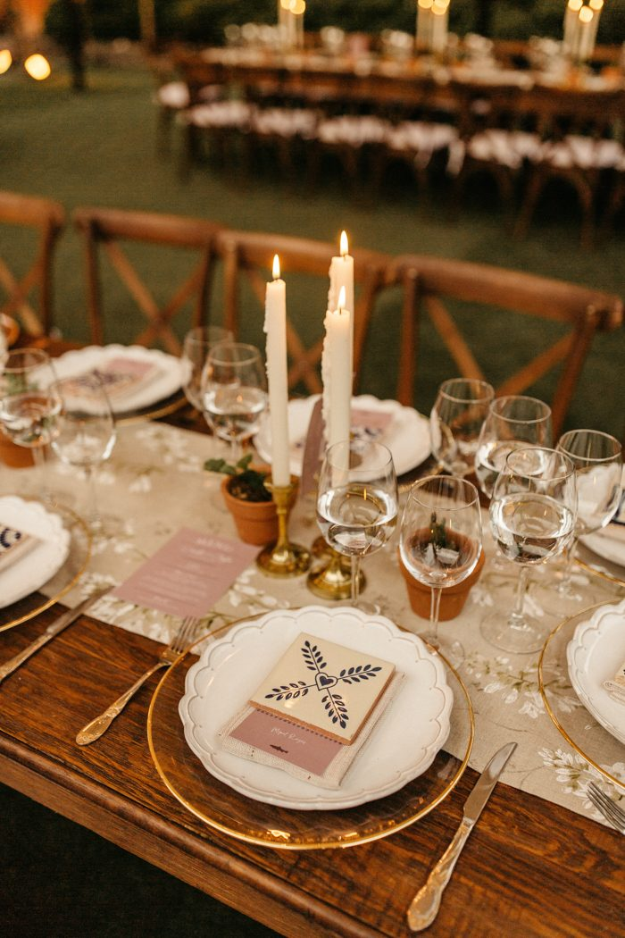 The tables were done with neutral floral print table runners, sheer chargers, candles and potted greenery