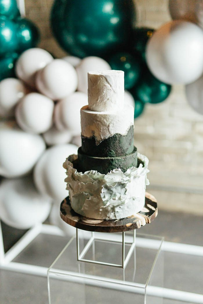 The wedding cake was done with plenty of texture, in dark green and white