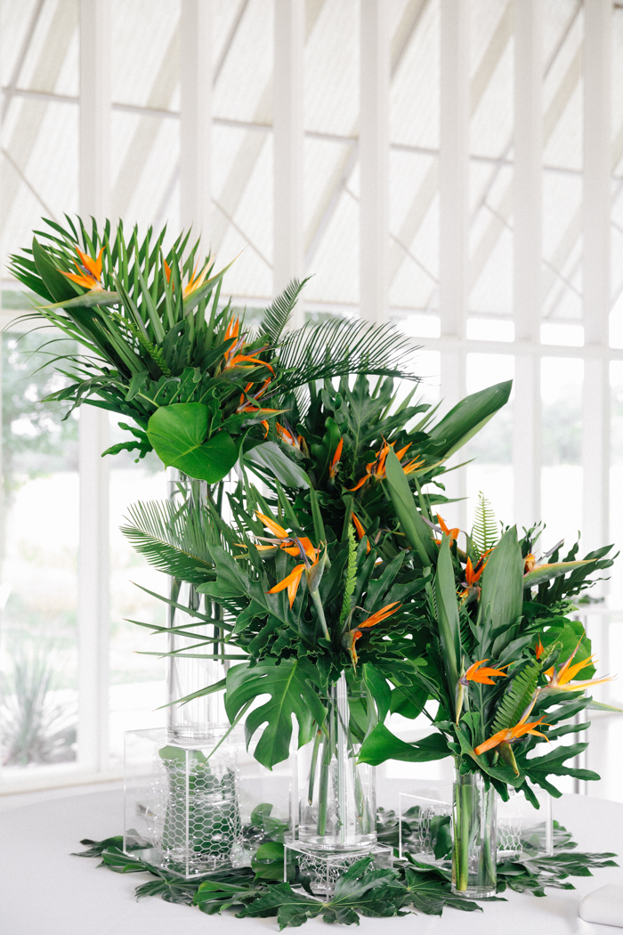 Tropical decor was all over, with lots of fronds and bold blooms and clear vases