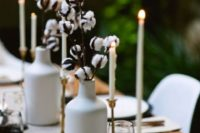 09 cotton branches in white vases are great to add a soft natural feel to your modern winter table
