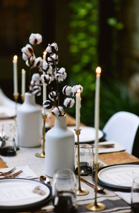 cotton branches in white vases are great to add a soft natural feel to your modern winter table