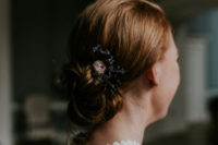 10 Her red hair was a low updo accented with some dried blooms
