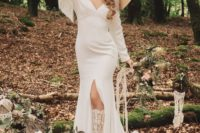 10 The bride tried on one more wedidng gown – a fitting plain one with a front slit and fringe plus a large hat