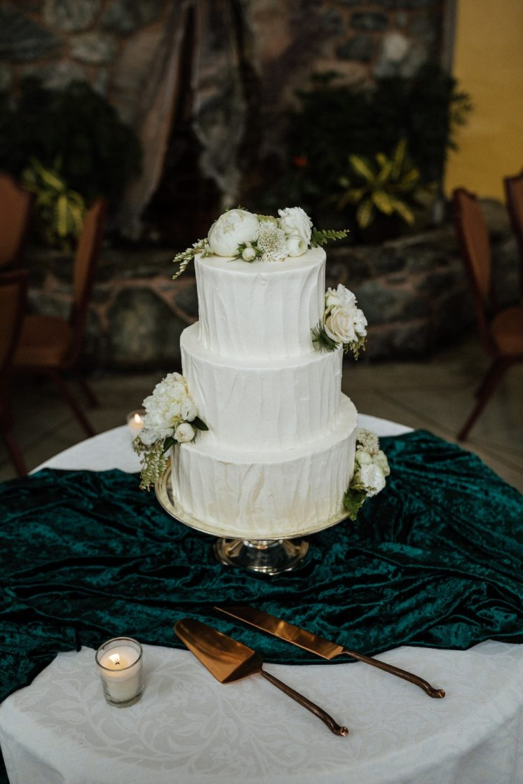 The wedding cake was a white textural one, with neutral blooms