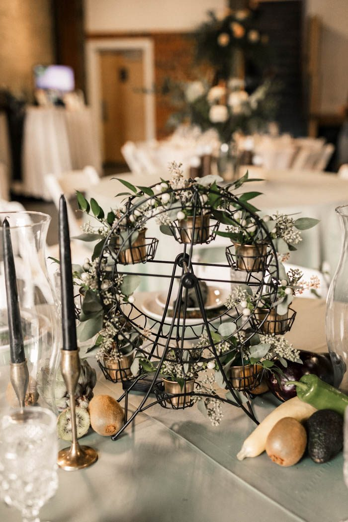 Such quirky wheel centerpieces with greenery were also incorporated into decor