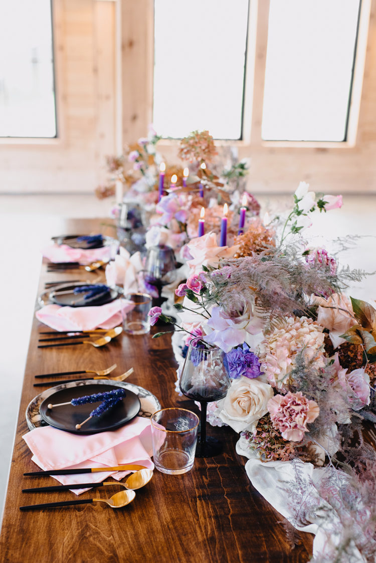 The chargers were marble ones, black plates were paired with black cutlery and purple rock sugar candies