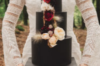 11 The wedding cake was a black one, with bold and neutral blooms and a bit of gold