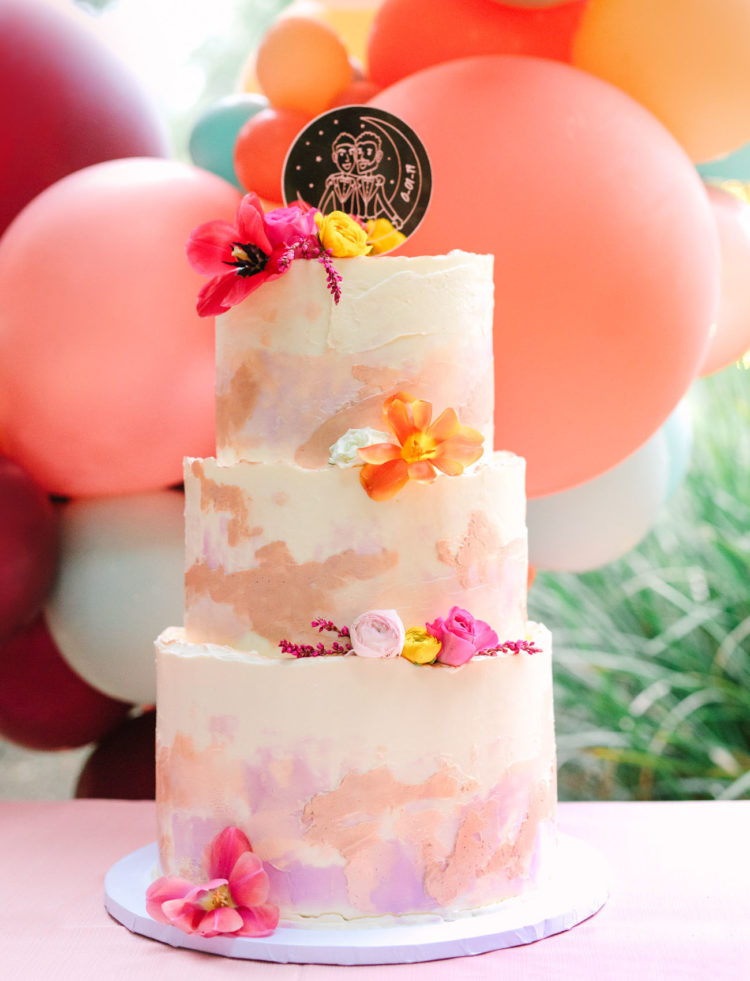 The wedding cake was a bright watercolor one, with brushstrokes and bright blooms