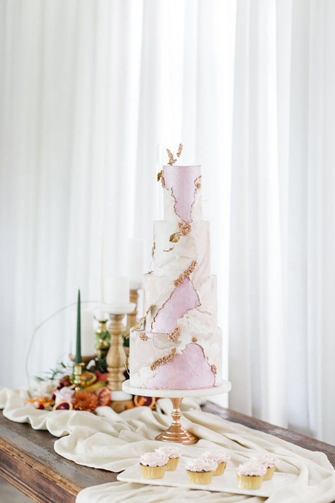 The wedding cake was done in pink and white, with plenty of texture and rose gold florals