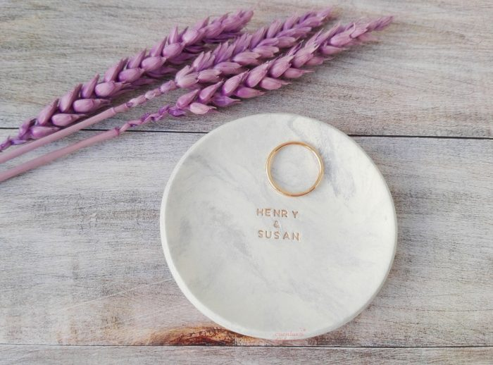 a marble ring dish with couple's names is amazingly minimalist and very trendy