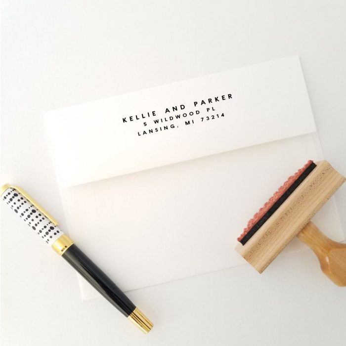 a minimalist return address stamp is a chic and very modern idea for a newly engaged or married couple